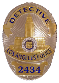 Badge of an LAPD detective with the badge number 2434.