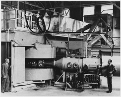 Lawrence's 60 inch cyclotron, with magnet poles 60 inches (5 feet, 1.5 meters) in diameter, at the University of California Lawrence Radiation Laboratory, Berkeley, in August, 1939, the most powerful accelerator in the world at the time. Glenn T. Seaborg and Edwin McMillan (right) used it to discover plutonium, neptunium and many other transuranic elements and isotopes, for which they received the 1951 Nobel Prize in chemistry.