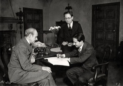 From left, Joseph P. Bickerton, Jr. (theatre producer), Elmer Rice (playwright) and Carl Laemmle Jr. (Universal producer) sign a contract for the film version of Counsellor at Law