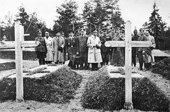 Secretary of State of the Vichy regime Fernand de Brinon (white coat) and other French and German officers visiting the graves of anticommunist Poles killed by the USSR's NKVD during the 1940 Katyn massacre, in 1943. This event was exploited by the anti-bolshevik Vichy French propaganda (watch the newsreel).