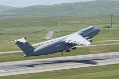 A C-5 Galaxy takes off from Travis AFB during the Thunder Over Solano Air Show in May 2014.