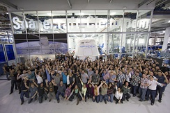 SpaceX employees with the Dragon capsule at SpaceX HQ in Hawthorne, California, February 2015