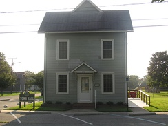 The Ellendale Town Hall located at the corner of Willow Street & McCaulley Avenue. The town police station is located on the 2nd floor.