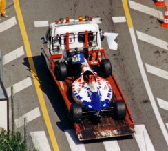 Inoue's damaged car is towed back to the pits after his bizarre practice accident at the 1995 Monaco Grand Prix.