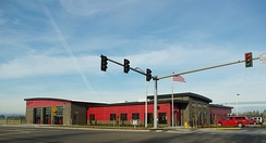 The Jones Farm fire station is one story tall with gray concrete blocks and red colored brick on the exterior.