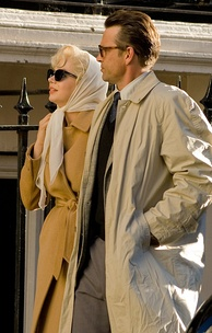 A photograph of Dougray Scott and Michelle Williams filming in character for My Week with Marilyn