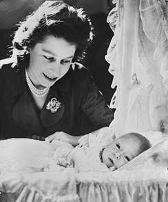 Princess Elizabeth with her one-month-old son Prince Charles of Edinburgh, in London on 14 December 1948.