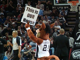 The Coyote showing a sign to the crowd during a time-out at a Spurs game.