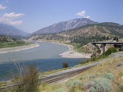 The confluence of the Fraser and Thompson rivers showing the mixing of the two different coloured waters.  Botanie Mountain right background, Lillooet Ranges at left.