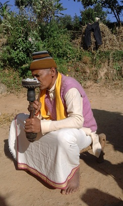 A man smoking Tobacco on Hukka in Darchula, Nepal