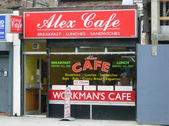"The British cafe (such as this one in Islington, London, with a ""breakfast served all day"" sign) typically serves the full breakfast throughout the day"