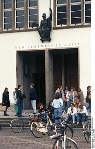 The main entrance of the New University building in 1988, showing the bronze bust of Athena, the Greek goddess of wisdom.