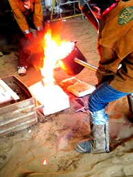 Casting iron in a sand mold
