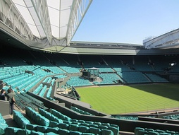 Centre Court at Wimbledon. First played in 1877, the Championships is the oldest tennis tournament in the world.[375]