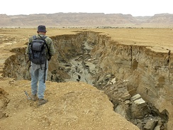 Gully in unconsolidated Dead Sea sediments exposed by recession of water levels. It was excavated by floods from the Judean Mountains in less than a year.