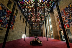 The Great Hall ceiling, the world's largest stained-glass ceiling, designed by Melbourne artist Leonard French[8]