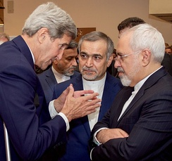Kerry with Hossein Fereydoun and Mohammad Javad Zarif during the announcement of the Joint Comprehensive Plan of Action, July 14, 2015