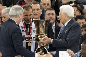 Chiellini (center), Juventus' captain during the 2016 Coppa Italia Final, receives the trophy by the President of the Italian Republic Sergio Mattarella (right).