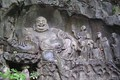 Maitreya and disciples in budai form, as depicted at the Feilai Feng grottos near Lingyin Temple in Hangzhou, China