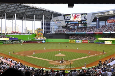 The Miami Marlins in front of a sellout crowd at the inaugural Opening Night game at Marlins Park against the reigning World champion St. Louis Cardinals