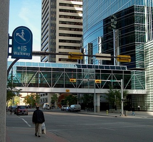 Facing north, +15 sign and covered walkway linking the TransCanada Tower (east) and Fifth Avenue Place