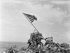 U.S. Marines raising the American flag on Mount Suribachi during the Battle of Iwo Jima in one of the most iconic images of the war.