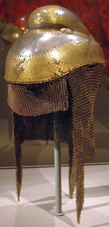 Sikh warrior helmet with butted mail neckguard, 1820–1840, iron overlaid with gold with mail neckguard of iron and brass