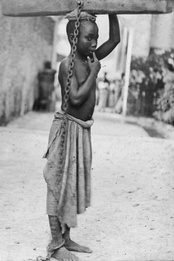 A photograph of a slave boy in the Sultanate of Zanzibar. 'An Arab master's punishment for a slight offence.' c. 1890. From at least the 1860s onwards, photography was a powerful weapon in the abolitionist arsenal.