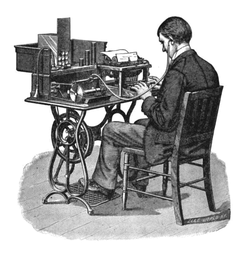 A 'G' (Graham Bell) model Graphophone being played back by a typist after its cylinder had recorded dictation.