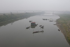 Hong River in fog, Hanoi, Vietnam.