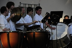 Orchestral percussion section with timpani, unpitched auxiliary percussion and pitched tubular bells