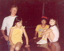 Archie Kao in 1982 with younger sisters and neighbor across the street in Alexandria, Virginia.
