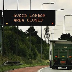 A sign on the M25 London orbital road warns drivers to avoid the city.