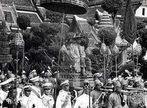 Bhumibol at his coronation, on a royal procession.