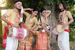Men playing Assamese dhol during Bihu, Assam, India
