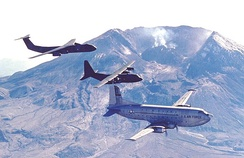 From left to right: C-141, C-130, and C-124 with Mt. St. Helens in the background