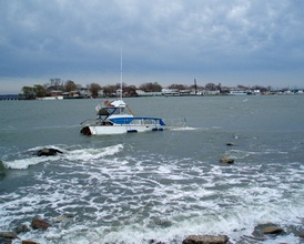 Wreck on rocks off Orchard Beach, New York, The Bronx during the winter of 2007.