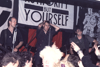 Crass, shown here in 1984, played a major role in introducing anarchism to the punk subculture.