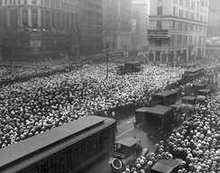 A crowd outside The New York Times building follows the progress of the Jack Dempsey–Georges Carpentier fight in 1921