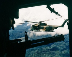 A HH-53 seen from the gunner's position of a helicopter over Vietnam in October 1972