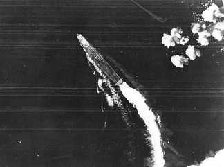 June 4: The Japanese aircraft carrier, Hiryū under attack by US aircraft at the Battle of Midway