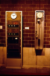 The first Swiss quartz clock, which was made after WW II (left), on display at the International Museum of Horology in La Chaux-de-Fonds