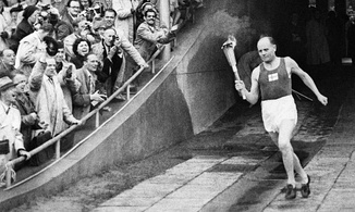 Paavo Nurmi enters the Helsinki Olympic Stadium through the marathon gate during the opening ceremonies. He became the first well-known athlete to light the Olympic Flame.