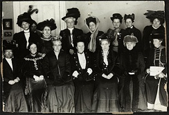 Suffrage Alliance Congress with Millicent Fawcett presiding, London 1909. Top row from left: Thora Dangaard (Denmark), Louise Qvam (Norway), Aletta Jacobs (Netherlands), Annie Furuhjelm (Finland), Madame Mirowitch (Russia), Käthe Schirmacher (Germany), Madame Honneger, unidentified. Bottom left: Unidentified, Anna Bugge (Sweden), Anna Howard Shaw (USA), Millicent Fawcett (Presiding, England), Carrie Chapman Catt (USA), F. M. Qvam (Norway), Anita Augspurg (Germany).