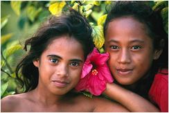 Two Tahitian girls with a hibiscus flower