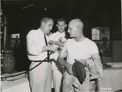 SP5 Lawrence E. Blackman (Darlington, SC) Hq & Hq Co, USASTC, receives the first typhus shot administered by a jet injector at Fort Gordon by Mr. John R. Gordon, representative of the R.P. Scherer Corp., Detroit, Michigan, August 1959.
