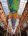 The street-length canopy of Victoria Quarter, Leeds, the largest stained glass work in Great Britain