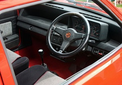 The interior of a 1982 MG Metro MkI. The MkII featured a much updated and revised interior with controls moved away from the centre console and onto the dashboard.