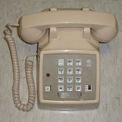 Wired telephone that uses 4P4C connectors for the coiled handset cord.