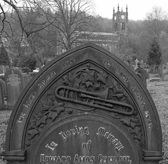 Trombone on a 1909 headstone, Christ Church, Todmorden